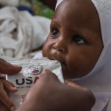 A child receives food rations due to UNICEF's support