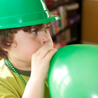 Boy with green balloon