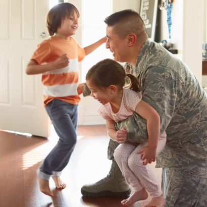 Military dad with children