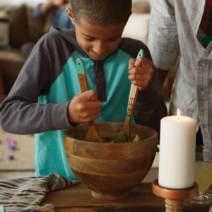 Boy mixing salad