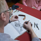 Hallmark Cards' master artist and illustrator, Geoff Greenleaf on set drawing Santa Claus