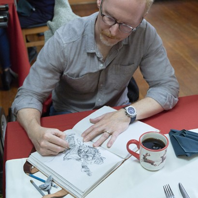 Hallmark Cards' master artist and illustrator, Geoff Greenleaf on set working on an illustration
