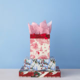 Assortment of holiday gift bags and wrapping paper